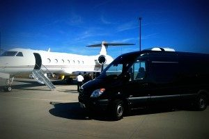 Image of Mercedes sprinter van next to an airplane at JFK airport